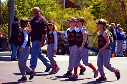 Riley marching with her OOB Fire Rescue Little League team. Her mom was embarrassing her, so she wouldn't look at the camera.