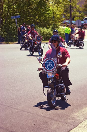 Shriner cyclists performing along the parade route.