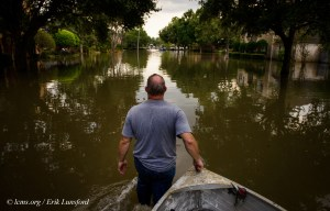 David Kunz of Memorial Lutheran Church, Houston, walks a boat through a flooded neighborhood on Monday, Sept. 4, 2017, in Houston. LCMS Communications/Erik M. Lunsford