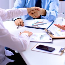 People shake hands after a business meeting
