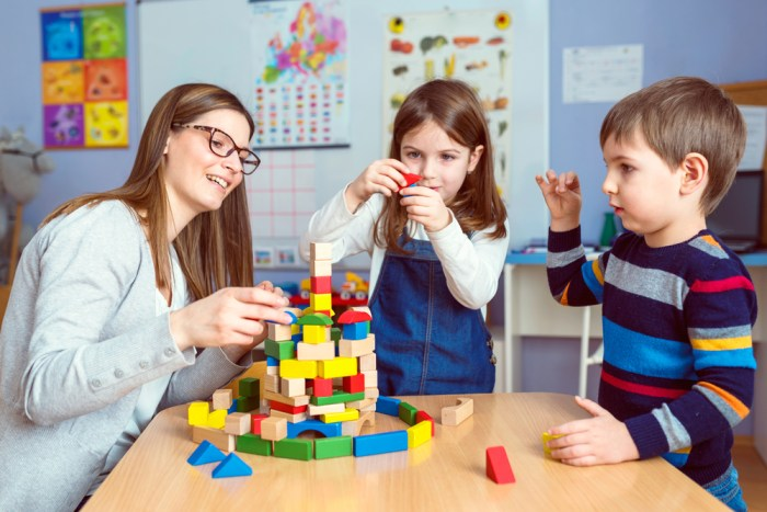 Teacher,And,Kids,Playing,Together,With,Colorful,Toy,Building,Blocks