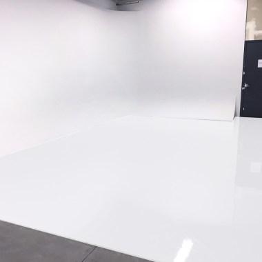 white epoxy floor photo studio