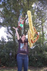 Dana King throws her leis in the air from Hawaii to display how many she has.