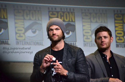Jared Padalecki holds up the candle he received the previous year.