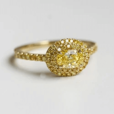 MONOCHROMATIC YELLOW EAST-WEST DIAMOND CLUSTER RING