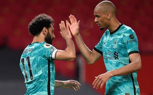 Liverpool wins 4-2 against Man United in late push for Champions League spot