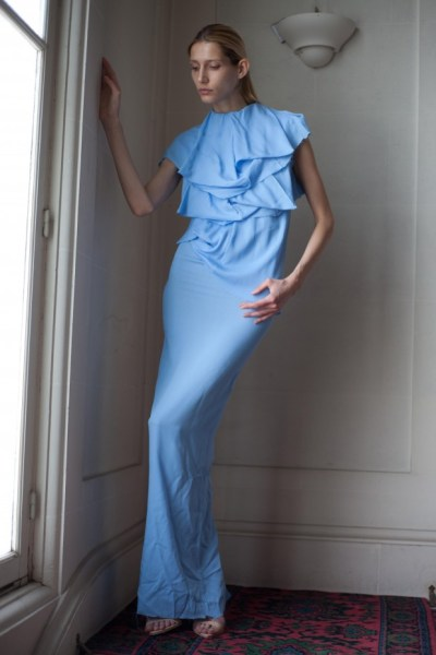 This piece is one of the softer pieces in the AW collection, in a powder blue and more ruffled torso, it has a simple femininity to it.