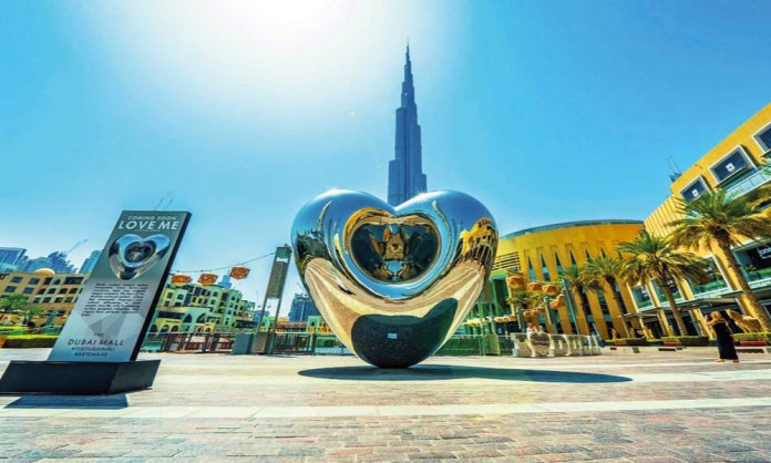 Love me statue in front of Burj Khalifa