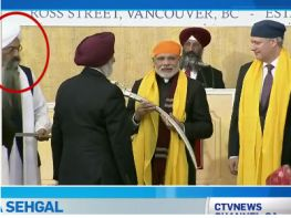 When Modi and Harper on their way out, Granthi still standing there