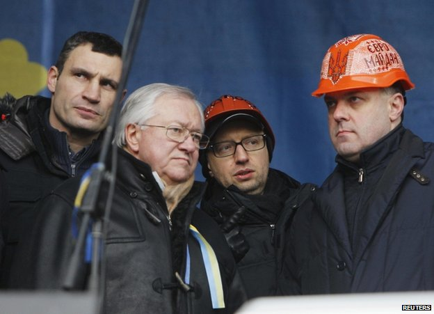 Former Ukrainian Foreign Minister Borys Tarasyuk (second from left) was among those taking the stage