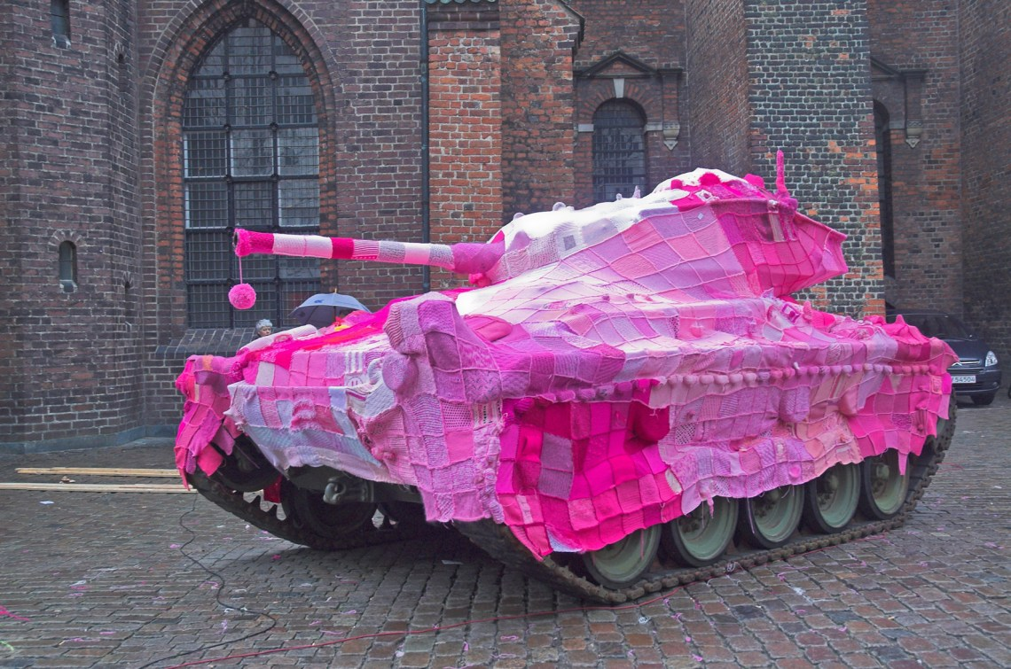 In 2006, Danish artist Marianne Joergensen stitched a pink blanket over a combat tank to protest Denmark's involvement in the Iraq war. With volunteers contributing nearly 4000 knitted squares, the power of the piece is in people coming together to send a common message, Joergensen explains.