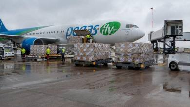 Photo of Fluid-resistant gowns arrive in Wales from Cambodia
