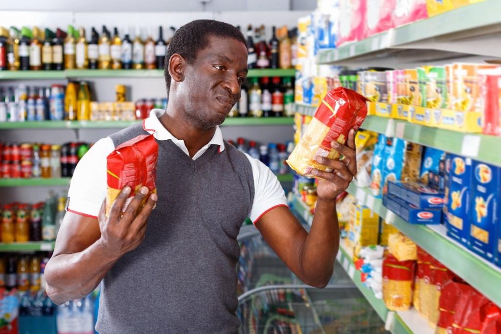Man comparing food labels