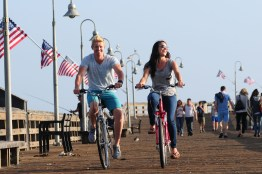 A couple enjoying riding along the boardwalk