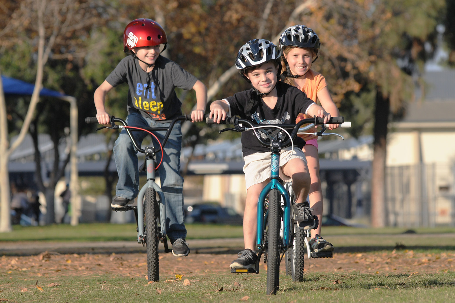 Three children riding Free Agent BMX bikes together
