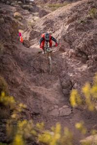 KHS pro mtb team rider Steven Walton dropping down a clift at Bootleg canyon.