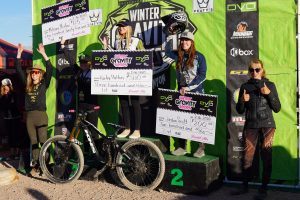 KHS Pro MTB team rider Kailey Skelton on the podium in first place at round two of the Dvo winter gravity series.