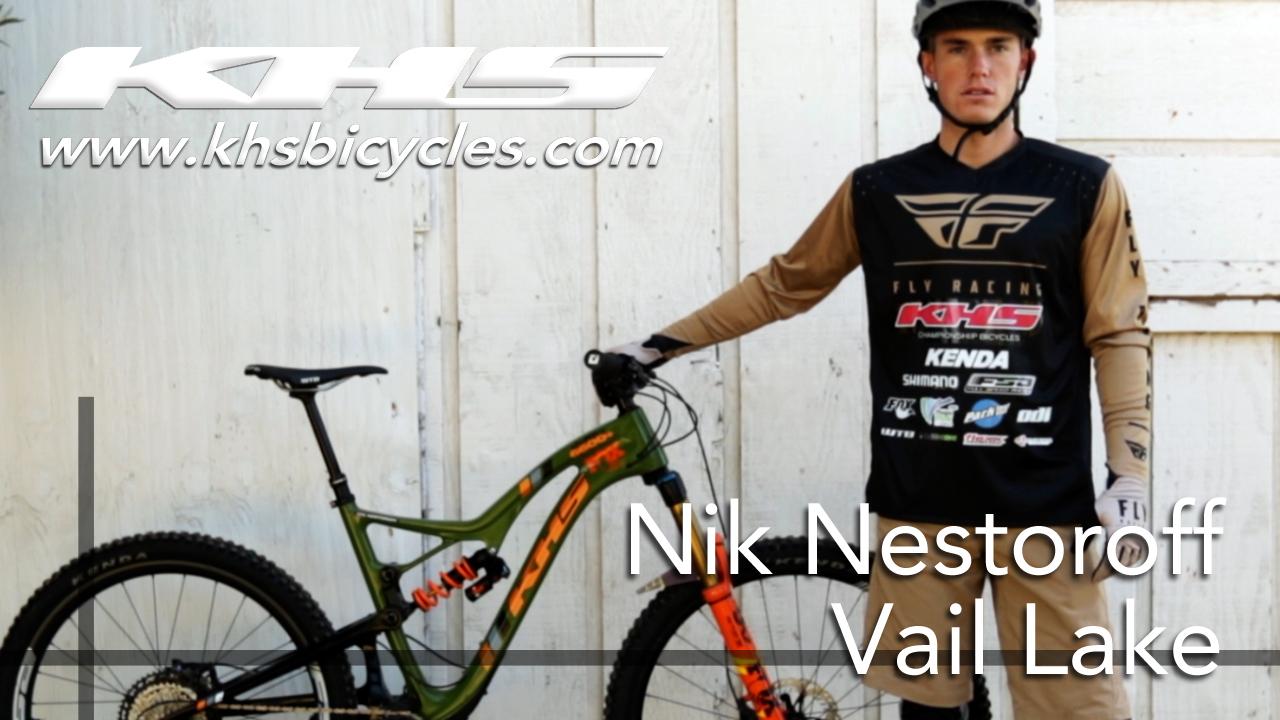 KHS pro MTB team rider Nik Nestoroff standing with his KHS 6600 bike