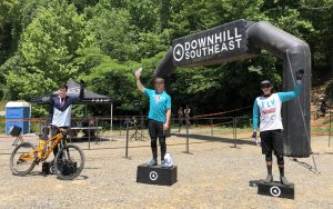 KHS Pro MTB team rider Seamus Powell standing on the podium in 3rd place at the Downhill Southeast downhill race at Windrock Tennessee.