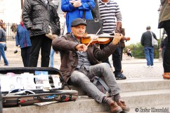 A street musician plays to the hearts of the crowds in beautiful Montmartre