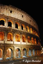 The worn yet beautiful Colosseum at night