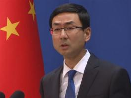China warns US to withdraw sanctions on military