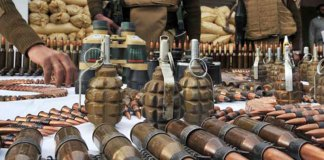 Huge cache of arms, explosives recovered