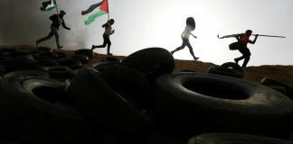 Israeli fire kills Palestinian at Gaza border, with more protests ahead