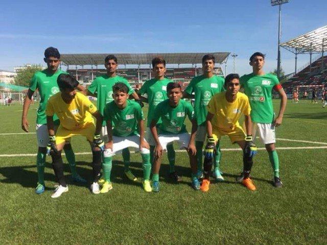 Pakistan street child football team returns home