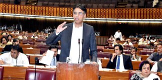 Finance Minister presents mini budget in NA amid opposition's protest