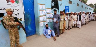 Unofficial estimates show big drop in voter numbers in Afghan election