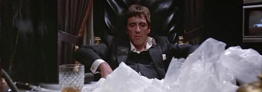 Tony Montana and a big ol pile of coke