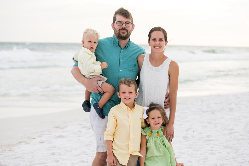 family portraits on beach vacation in Miramar, Florida