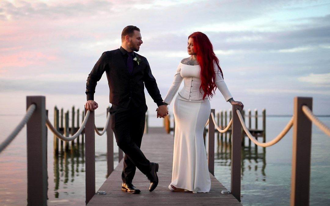 bride and groom portraits on the dock of Destin Bay House