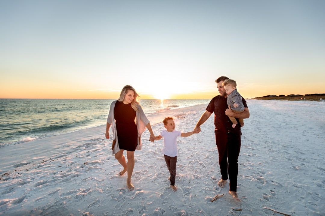 Okaloosa Island family photos walking at sunset