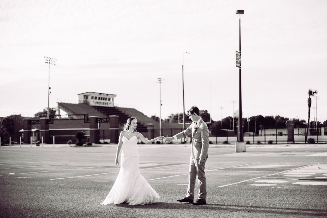 bride and groom dancing in Choctaw High School parking lot
