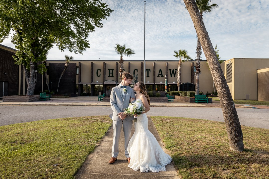 bride and groom in front of Choctawhatchee High School