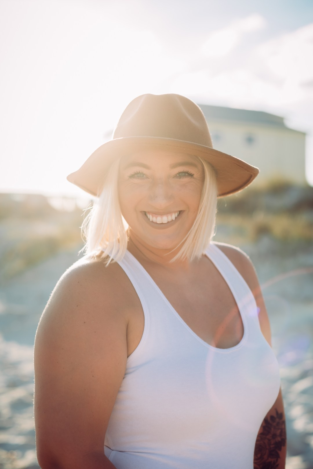 young woman wearing hat on the beach