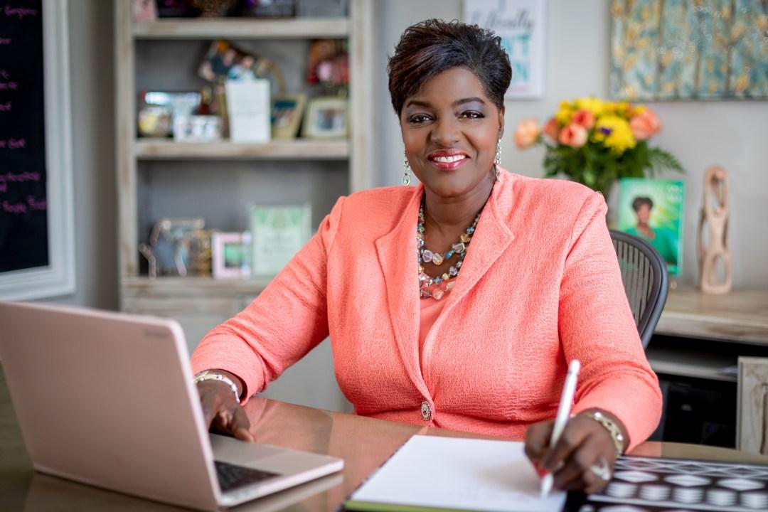 branding photograph of Dorothy Buckhanan Wilson sitting at desk