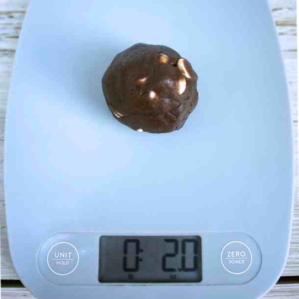 White Chocolate chip chocolate cookies measure 2 ounces on scale | kickassbaker.com #substantialcookies #biginsizebigonflavor #kickassbaker