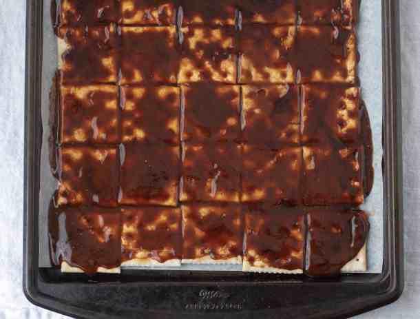 Biscoff White Chocolate Saltine Toffee | kickassbaker.com #biscoff #bark #holidaybaking #holidays #christmascookies #cookieexchange #whitechocolate #bakingrecipes #kickassbaker