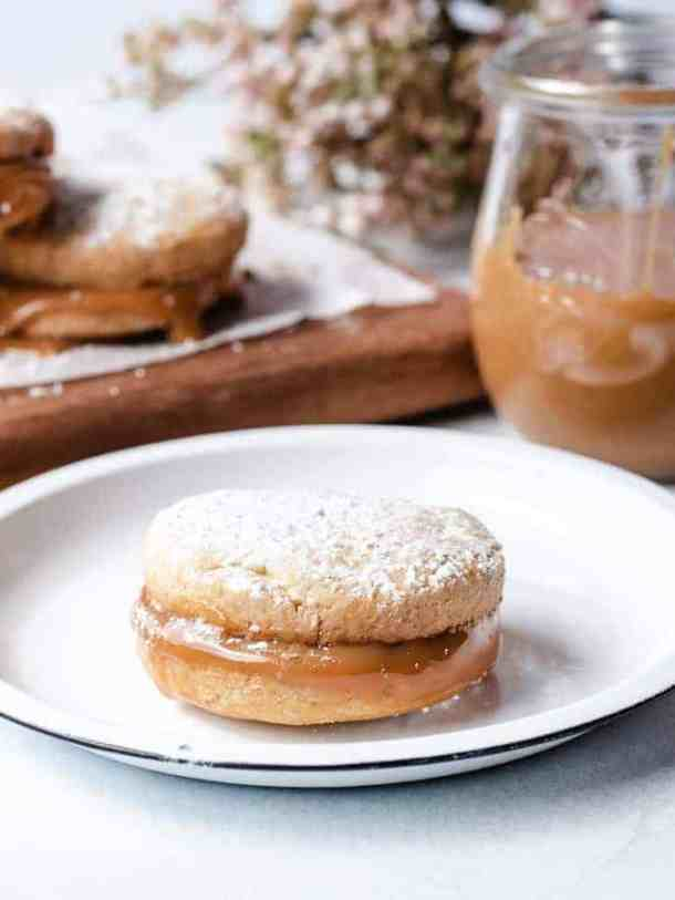 Alfajores | kickassbaker.com single sandwich cookie on a plate