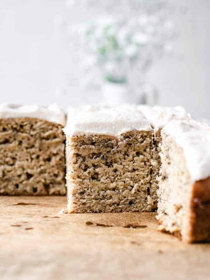 straight on photo of banana sheet cake with salted caramel buttercream cut into squares