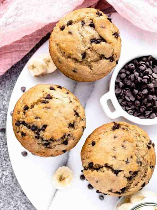 Overhead photo of 3 banana chocolate chip muffins