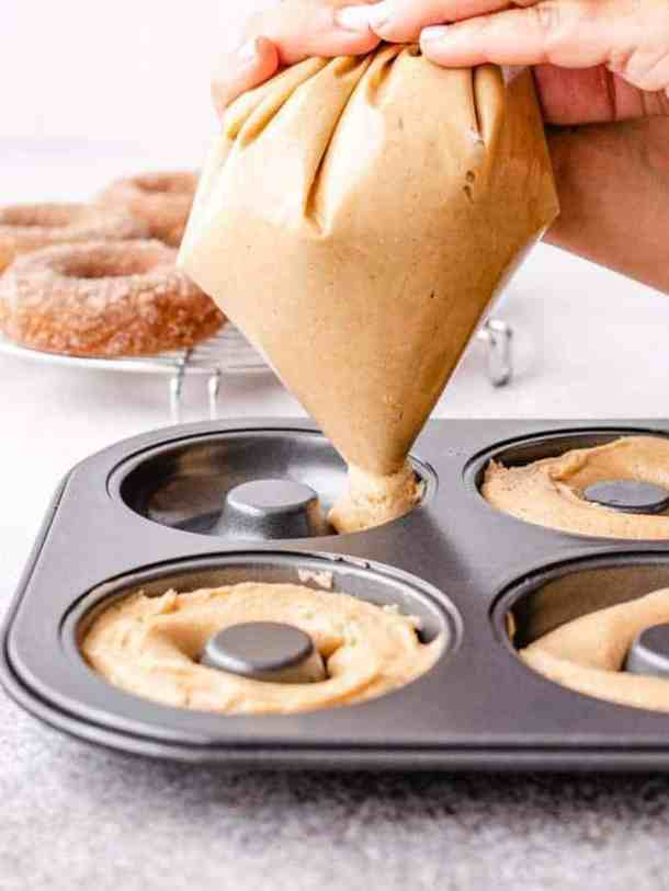 how to pipe donut batter into donut pans for baking