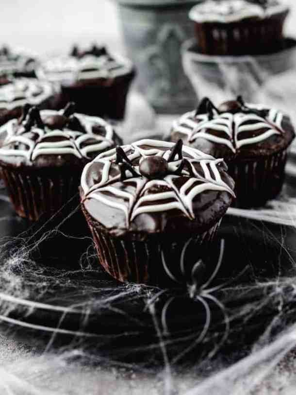 Image of halloween spider chocolate cupcakes with spider webs around