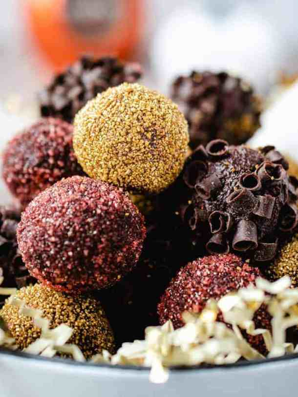 Bowl of holiday decorated pumpkin chocolate truffles