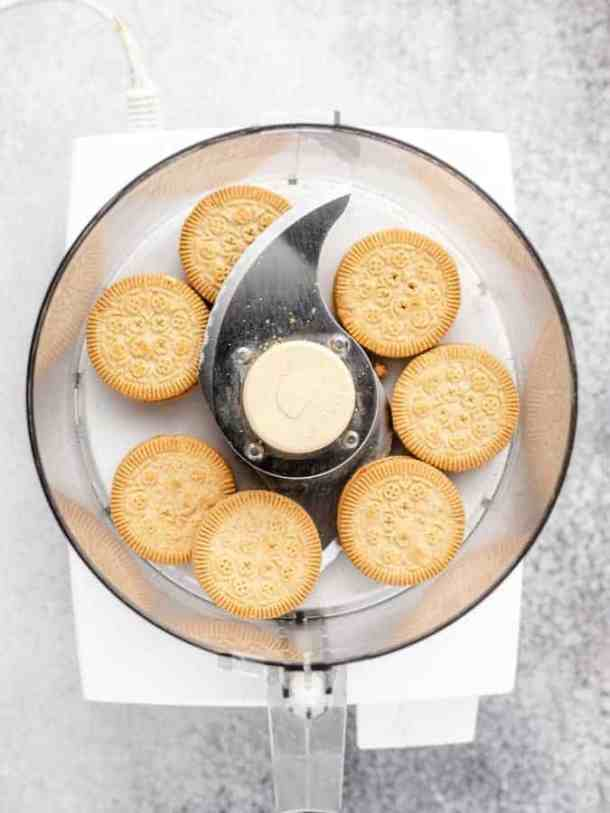 Overhead of food processor with sandwich cookies in it