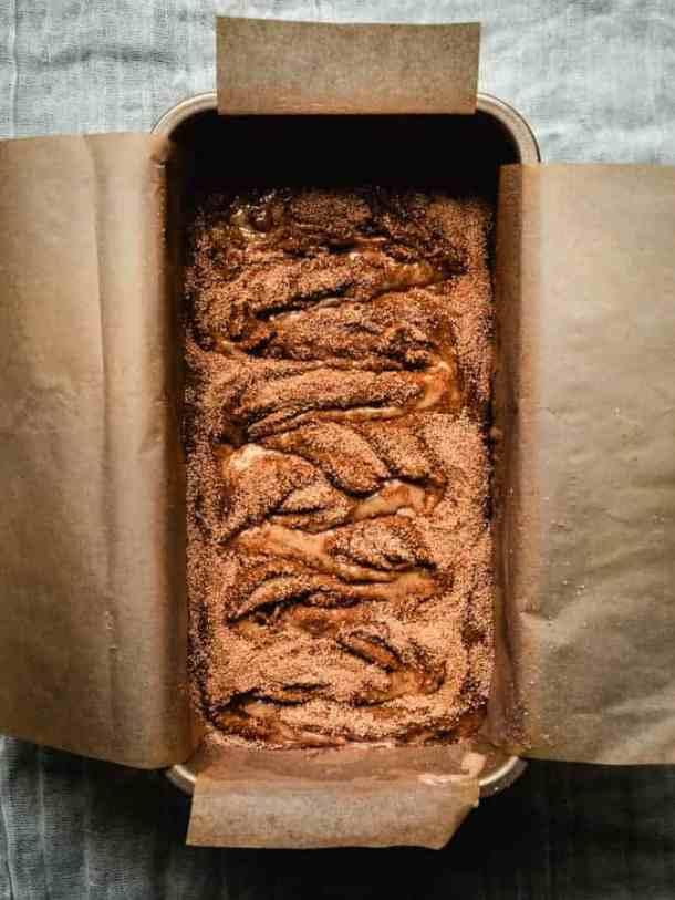 overhead of freshly baked cinnamon swirl bread in a loaf pan