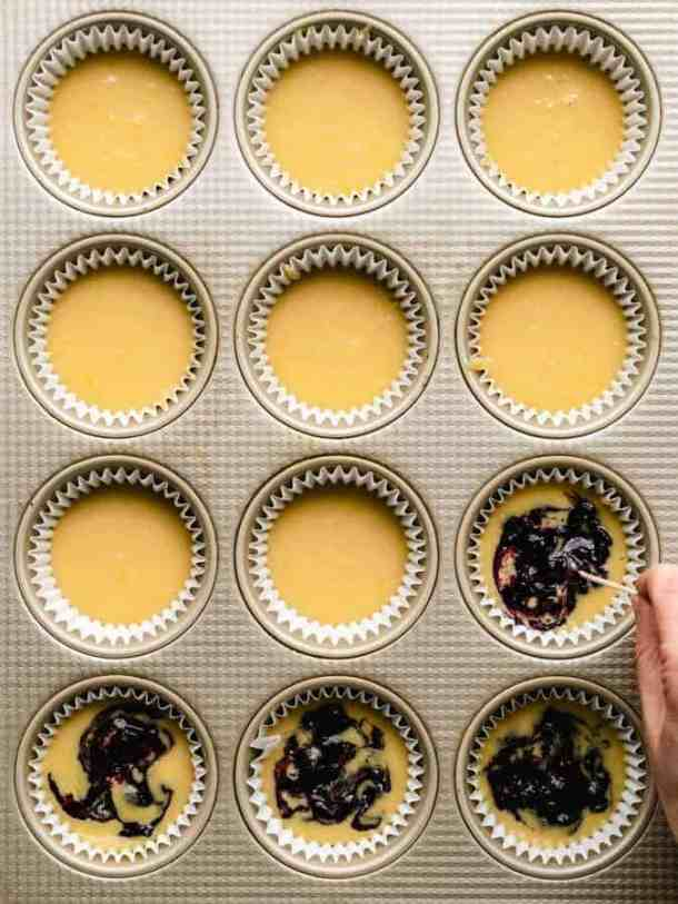 swirling blueberry jam into lemon muffin batter